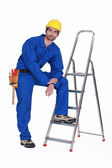 Handyman stood casually with ladder — Stock Photo
