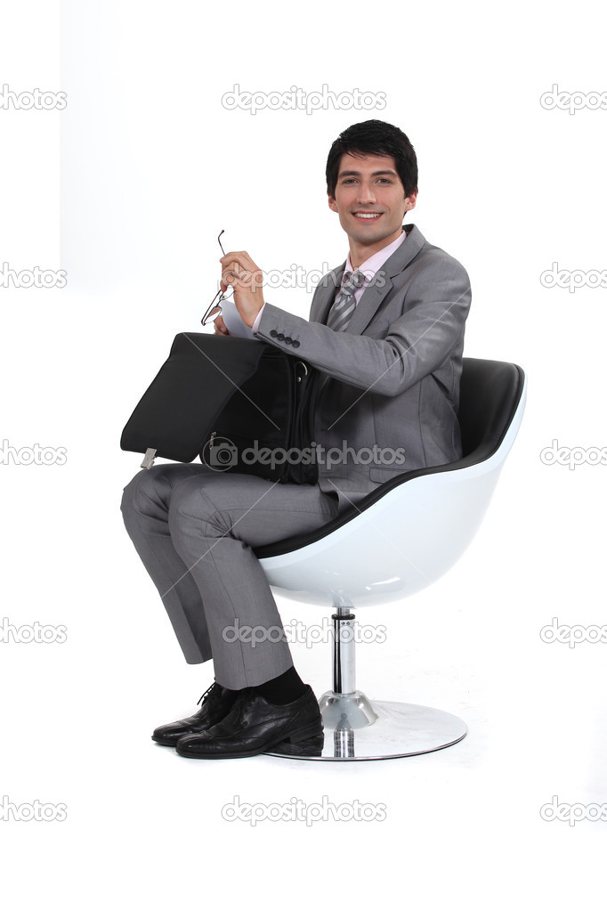 Businessman with an open briefcase — Stock Photo #15631397