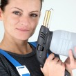 Woman with a blowtorch — Stock Photo