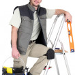 Tiler stood on ladder — Stock Photo