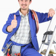 Stock Photo: Plumber with all his equipment making a thumbs up sign