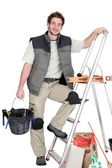 A tile fitter posing with his tools — Stock Photo