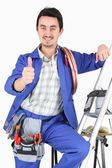 Plumber with all his equipment making a thumbs up sign — Stock Photo