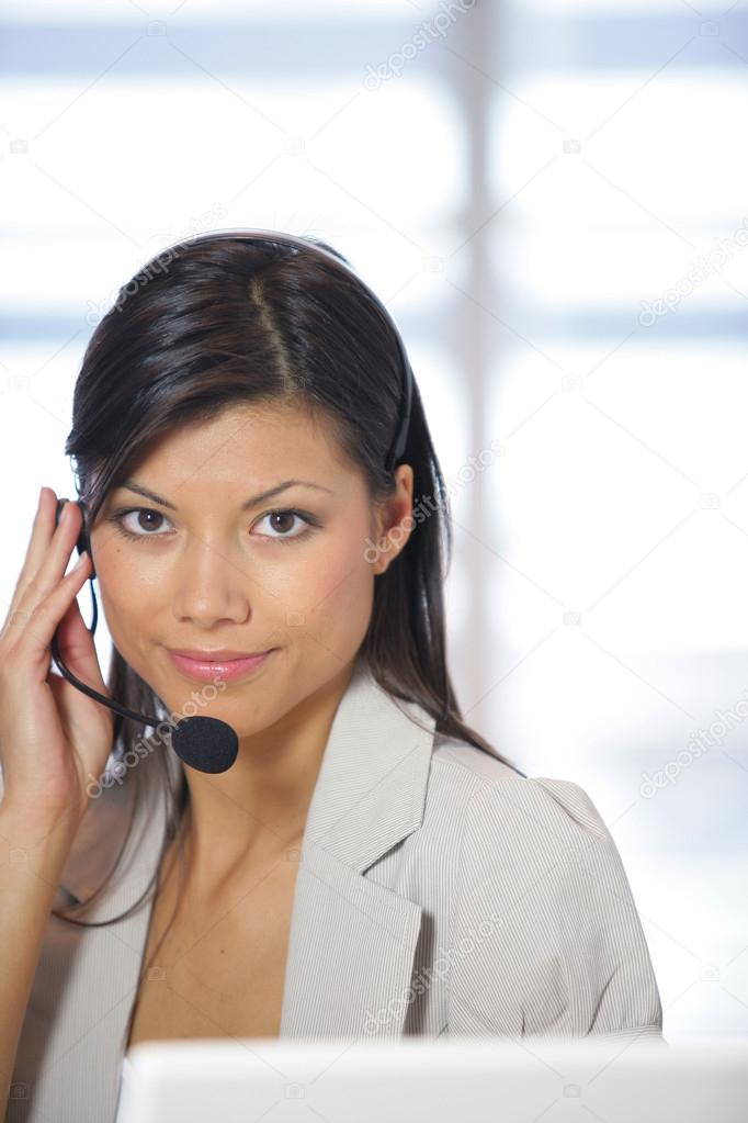 Call center employee wearing headset — Stock Photo #15739961