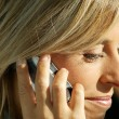 Closeup of a woman with a cellphone — Stock Photo