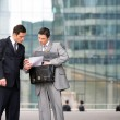 Two businessmen checking a document — Stock Photo