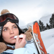Skier applying lip salve — Stok Fotoğraf #15743019