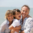 Happy family on the beach — Stock Photo