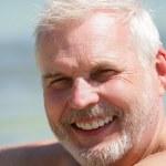 Happy senior at the beach — Stock Photo #15743689