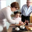 Couple with their grandchild at breakfast — Stock Photo