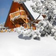Wooden house in the snowy hills — Stock Photo