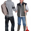 Manual worker welcoming teenage boy — Stock Photo #15748411