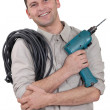 Electrician with drill and cable - Stock Photo