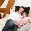 Stock Photo: Father cuddling his daughter