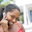 Happy woman making a phone call outdoors — Stock Photo #15749455