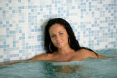 Woman in a hot tub — Stock Photo