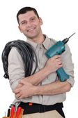 Electrician with drill and cable — Stock Photo