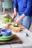 Man chopping vegetables — Stock Photo