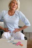 Senior woman suffering from stomach ache — Stock Photo