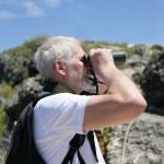 Man with binoculars — Stock Photo
