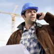 Stock Photo: Foreman using a mobile telephone