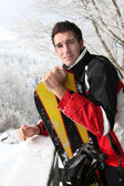 Man standing with his snowboard — Stock Photo