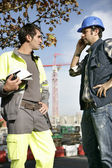 Construction workers handling a problem — Stock Photo