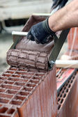 Close-up of bricklayer pouring cement — Stock Photo