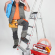 Stock Photo: Plumber on phone next to stepladder