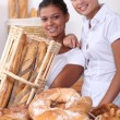 Two young women working in a bakery — Stock Photo #15935605