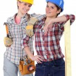 Two young women laborers in workwear — Photo