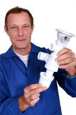 Plumber holding replacement part — Stock Photo