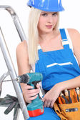 Tradeswoman posing with her tools — Stock Photo