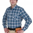 Builder stood with hands on hips - Stock Photo