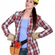 Stock Photo: Serious womwith tools