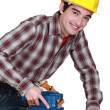 Man with a safety hat and a sander — Stock Photo