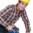 Stock Photo: Man with a safety hat and a sander