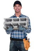 Mason carrying breeze block — Stock Photo