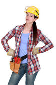Serious woman with tools — Stock Photo