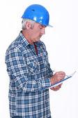 Tradesman taking notes — Stock Photo