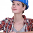 Female mason stood by unfinished wall — Stock Photo #15952803