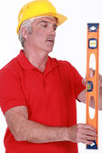 Laborer with spirit level — Stock Photo