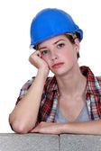 A bored tradeswoman — Stock Photo