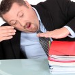 Stock Photo: Businessmwith pile of paperwork