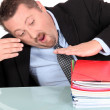 Businessman with a pile of paperwork — Stock Photo