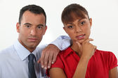 Young businessman and businesswoman posing together — Stock Photo
