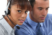 Call-center worker with supervisor — Stock Photo