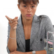 Irritated businesswoman showing you the way out — Stock Photo