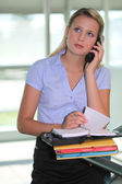 Secretary answering a telephone — Stock Photo