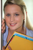 Student with folders — Stock Photo